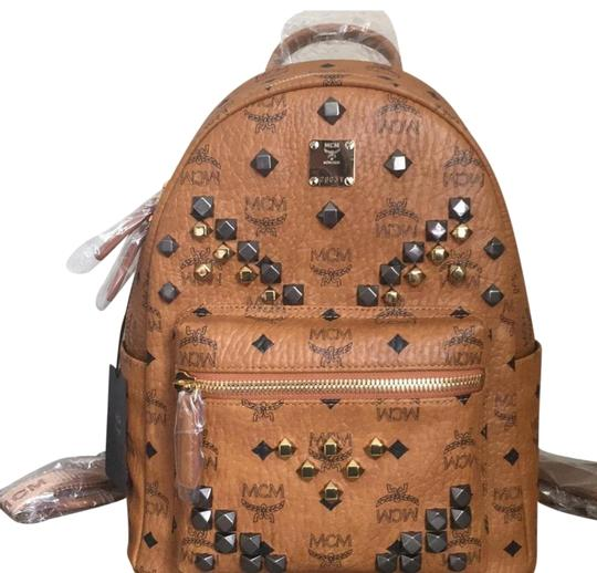 Preload https://img-static.tradesy.com/item/24443504/mcm-small-stark-m-stud-congac-backpack-0-3-540-540.jpg