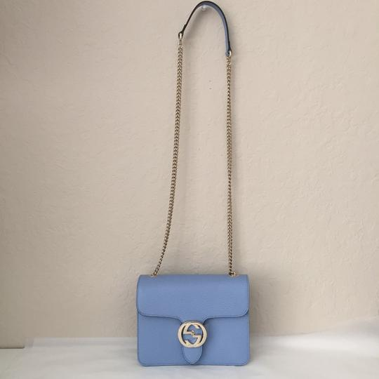 Preload https://item5.tradesy.com/images/gucci-interlocking-leather-with-chain-blue-cross-body-bag-24443624-0-1.jpg?width=440&height=440