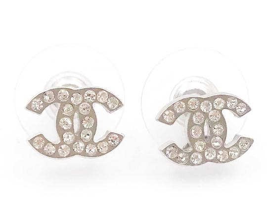 Preload https://img-static.tradesy.com/item/24444646/chanel-silver-classic-cc-crystal-small-piercing-earrings-0-0-540-540.jpg