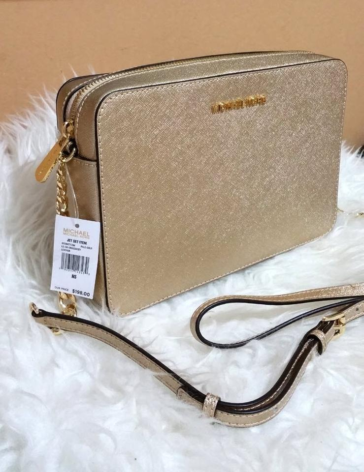 945dc6db1fe7 Michael Kors East West Jet Set Travel Large Gold Saffiano Leather Cross Body  Bag - Tradesy