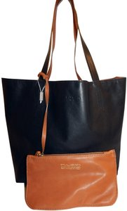 Pulicati Reversible Leather Pouch Tote in Black Brown