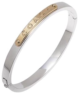 Coach NWT Coach Silver Bangle Bracelet with COACH embossed on Gold