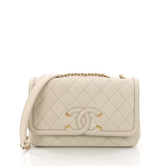 Preload https://img-static.tradesy.com/item/24457497/chanel-classic-flap-filigree-small-beige-quilted-caviar-shoulder-bag-0-0-540-540.jpg