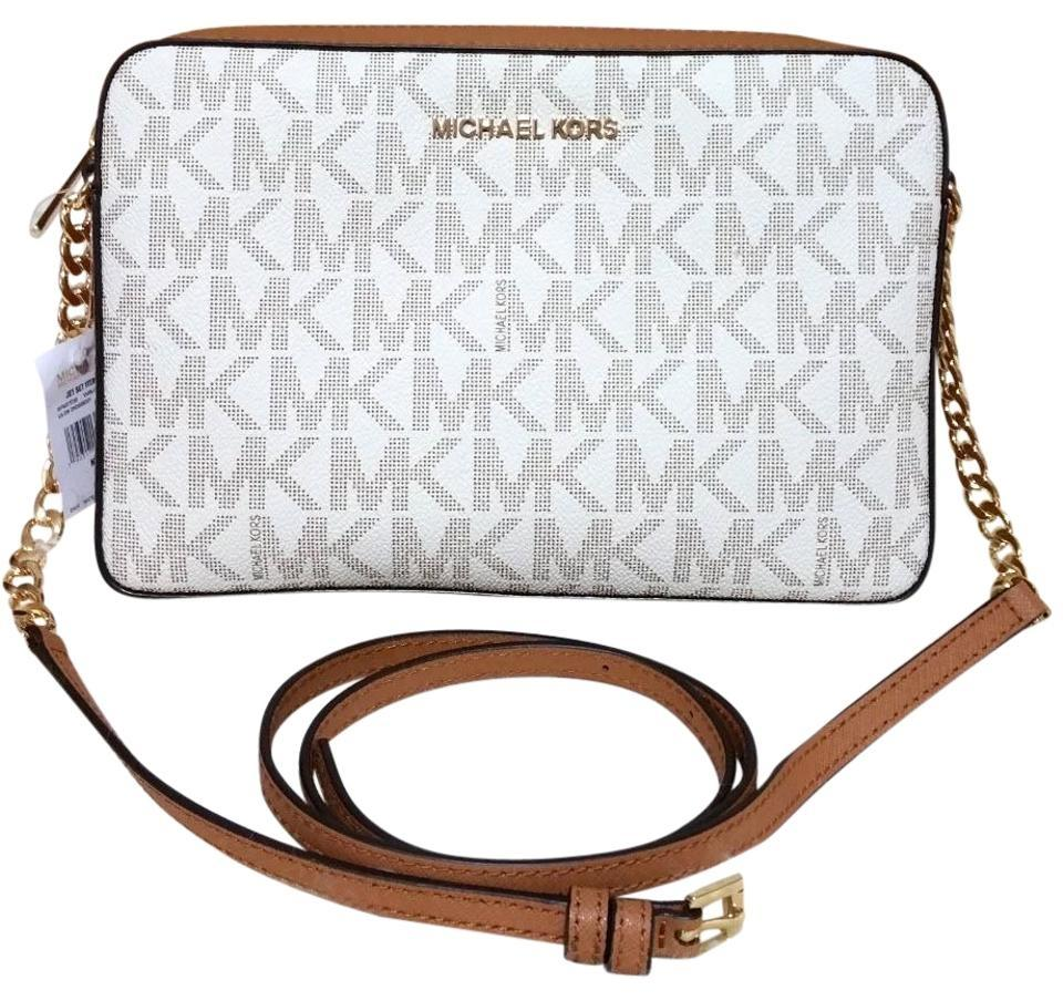 7c7f5f6e83fc Michael Kors Jet Set Travel Large East West Multicolor Vanilla Brown Canvas  Cross Body Bag