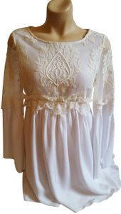 L'ATISTE short dress White Embroidered Empire Waist Cotton Longsleeve Lace on Tradesy