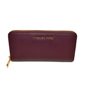 8ee19a89a264 Michael Kors Zip Around Continental Pebble Leather Jet Set Clutch