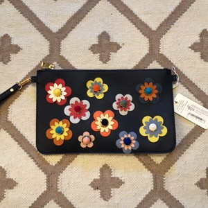 Urban Expressions navy with assorted flowers Clutch