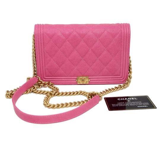 Preload https://img-static.tradesy.com/item/24475385/chanel-classic-flap-boy-quilted-caviar-small-woc-pink-leather-cross-body-bag-0-2-540-540.jpg