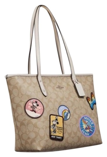 Preload https://img-static.tradesy.com/item/24475692/coach-disney-x-zip-w-minnie-mouse-patches-beige-multi-coated-canvas-tote-0-1-540-540.jpg