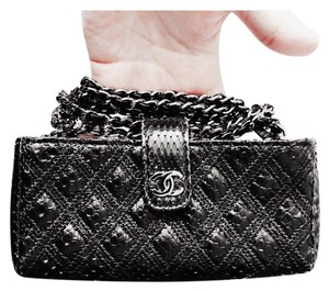 77258a186345 Chanel Cross Body Bag · Chanel. Clutch Exotic Leather Black Cross Body Bag.  $1,540.50 $2,700.00