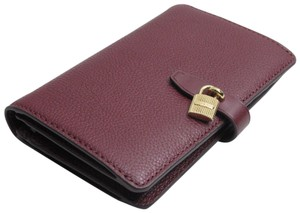 Michael Kors Adele Slim Bifold Merlot Pebbled Leather Wallet with Gold Logo Lock
