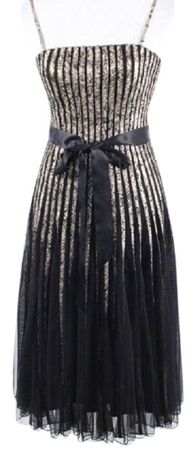 Preload https://img-static.tradesy.com/item/24480659/cache-blackgold-tulle-fit-and-flare-cocktail-mid-length-night-out-dress-size-4-s-0-1-650-650.jpg