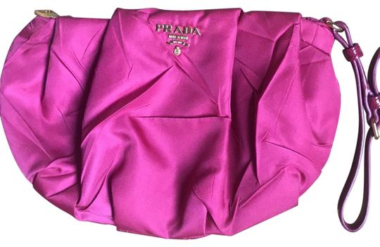 Preload https://img-static.tradesy.com/item/24480944/prada-canvas-with-gold-hardware-fuchsia-sateen-clutch-0-1-540-540.jpg