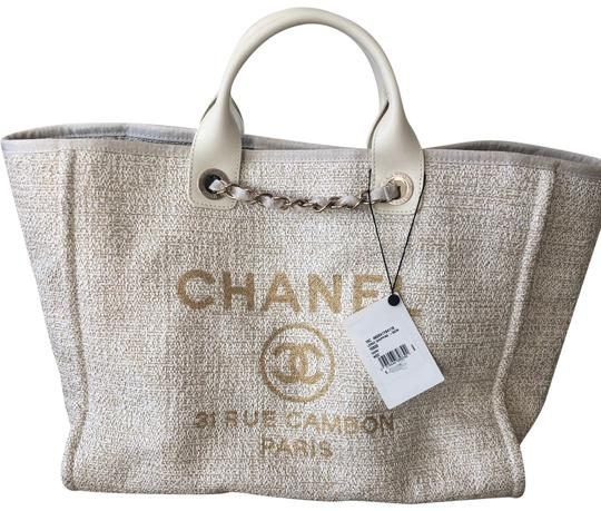 Preload https://img-static.tradesy.com/item/24486563/chanel-deauville-2019c-leather-with-gold-material-ivory-cotton-tote-0-6-540-540.jpg