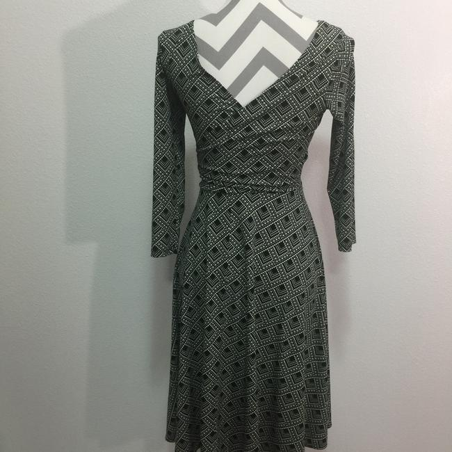 London Times short dress Black & White Faux Wrap And 3/4 Sleeve on Tradesy