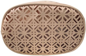 Tory Burch Beautiful Laser-Cut-Out Look Pattern