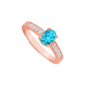 DesignByVeronica Blue Topaz and CZ Prong Set Ring in Rose Gold Vermeil