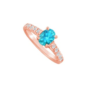 DesignByVeronica Oval Blue Topaz and CZ Ring in 14K Rose Gold Vermeil
