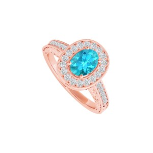 DesignByVeronica Blue Topaz and CZ Halo Ring in 14K Rose Gold Vermeil