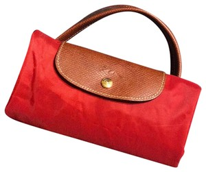 d8f7e2903fd Added to Shopping Bag. Longchamp Tote in red. Longchamp Le Pliage ...