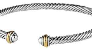 "David Yurman GORGEOUS!! LIKE NEW!! David Yurman 18 Karat Yellow Gold and Sterling Silver Cable Classic 4mm Bracelet Cuff 18 Karat Yellow Gold Sterling Silver 4mm Size: Medium 7.25"" Flexible sizing 100% Authentic Guaranteed!! Comes with Original David Yurman Pouch!!!"