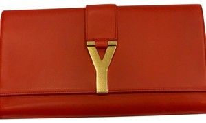 Saint Laurent Red with gold hardware Clutch