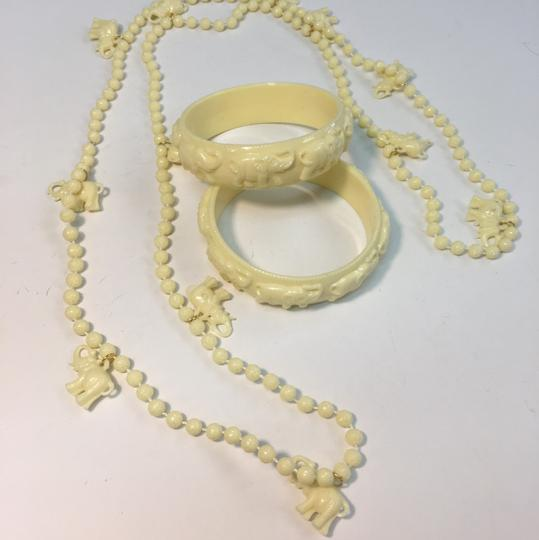 Vintage Vintage white plastic elephant bangle bracelet & Necklace Image 1