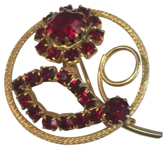Preload https://img-static.tradesy.com/item/24493652/red-rhinestone-gold-circle-brooch-pin-0-1-540-540.jpg