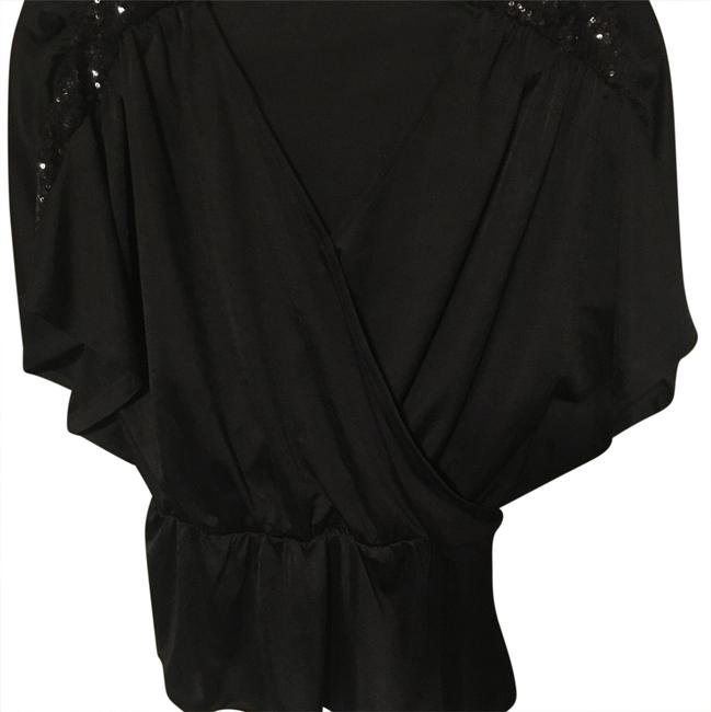 Preload https://img-static.tradesy.com/item/24493751/express-black-wrap-front-with-sequin-blouse-size-0-xs-0-1-650-650.jpg