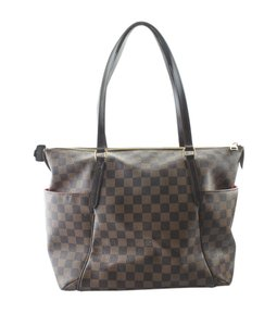 Louis Vuitton Canvas Gold-tone Adult Dustbag Tote in Brown
