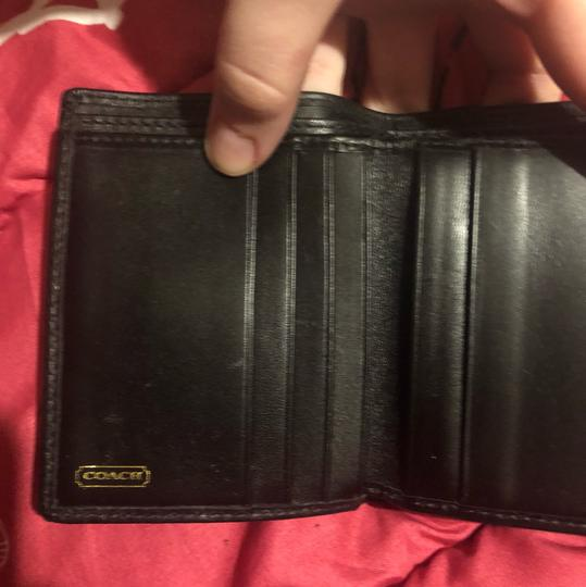 Coach Coach Signature black wallet.