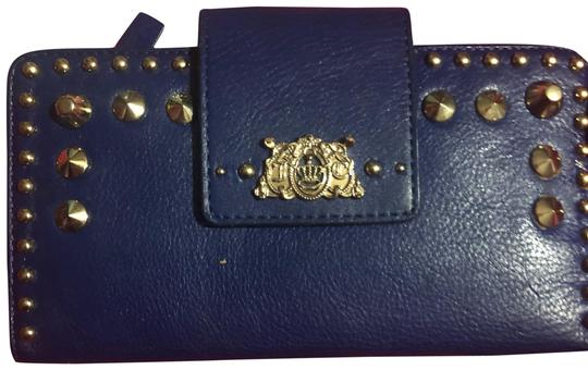 Preload https://img-static.tradesy.com/item/24499578/juicy-couture-blue-studded-wallet-0-1-540-540.jpg
