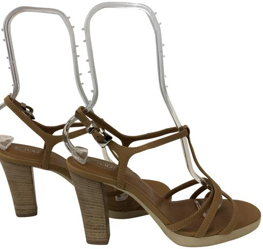 Preload https://img-static.tradesy.com/item/24502976/tod-s-tan-1211118-strappy-sandals-w-rubber-sole-and-wooden-heel-platforms-size-us-9-regular-m-b-0-1-540-540.jpg