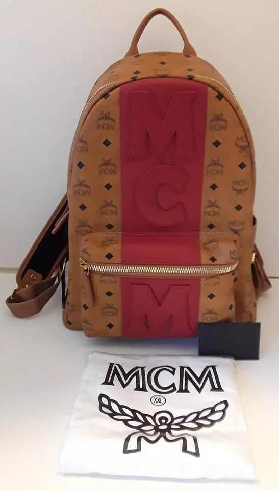 a44523aeb8933a MCM Stark Red Stripe Visetos Medium Cognac and Black Coated Canvas Backpack  - Tradesy