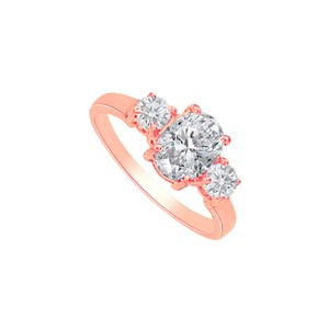 DesignByVeronica Cubic Zirconia Three Stones Ring in 14K Rose Gold