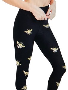 Ultracor Hi-rise waist gold bee leggings. size M