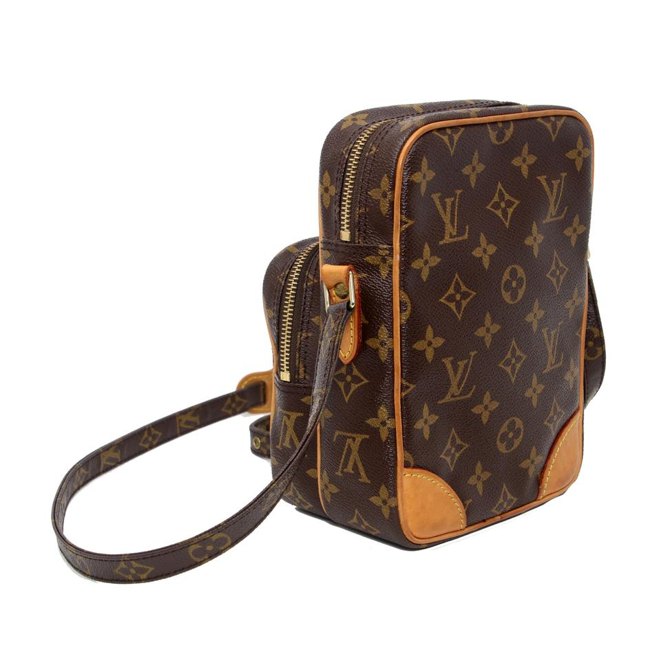 fb0735aaadf67 Louis Vuitton Amazon Monogram Canvas Camera Case Brown Cowhide Leather  Messenger Bag 63% off retail