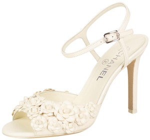 370a3679beb7 Chanel Lambskin Floral Open Toe Ankle Strap Ivory Pumps