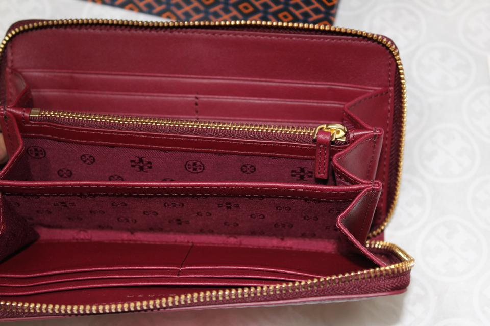 2cd9481f89d ... TORY BURCH CONTINENTAL BURGUNDY ZIP AROUND WALLET BAG NWT Image 11.  123456789101112