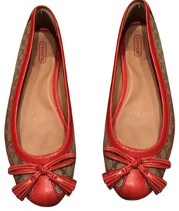 Coach tan with orange leather accents . Flats