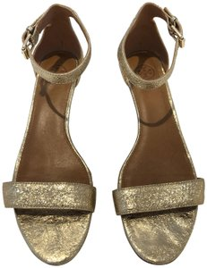 0a80962ca7c933 Gold Tory Burch Wedges - Up to 90% off at Tradesy