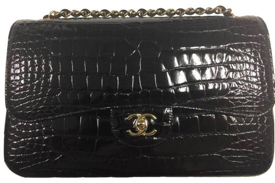 Preload https://img-static.tradesy.com/item/24539526/chanel-classic-flap-maxi-size-black-crocodile-skin-leather-shoulder-bag-0-1-540-540.jpg