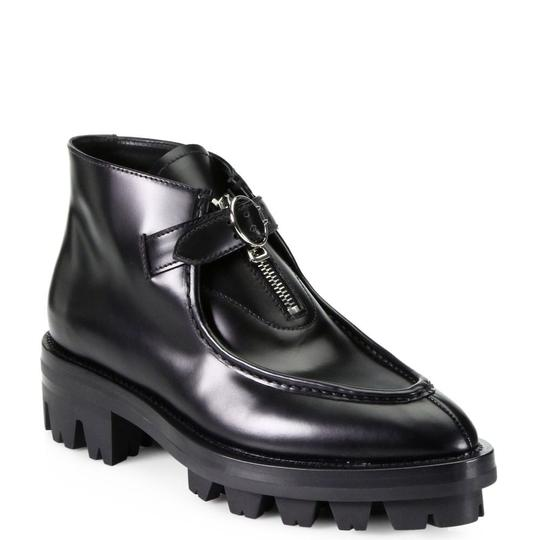Preload https://img-static.tradesy.com/item/24542065/prada-black-lux-spazzolato-bootsbooties-size-us-95-regular-m-b-0-0-540-540.jpg