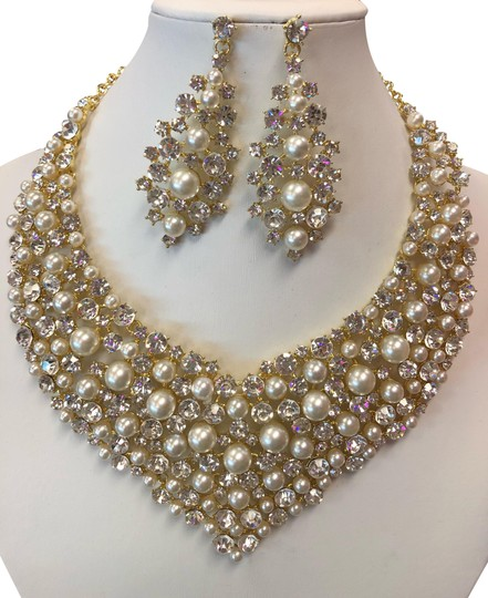 Preload https://img-static.tradesy.com/item/24543403/gold-and-ivory-and-clear-rhinestone-pearl-necklace-0-1-540-540.jpg