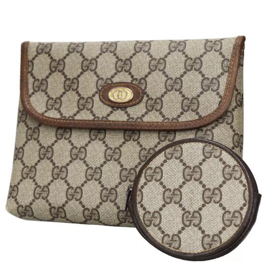 Preload https://img-static.tradesy.com/item/24546142/gucci-2-in-1-monogram-brown-pvc-clutch-0-0-540-540.jpg