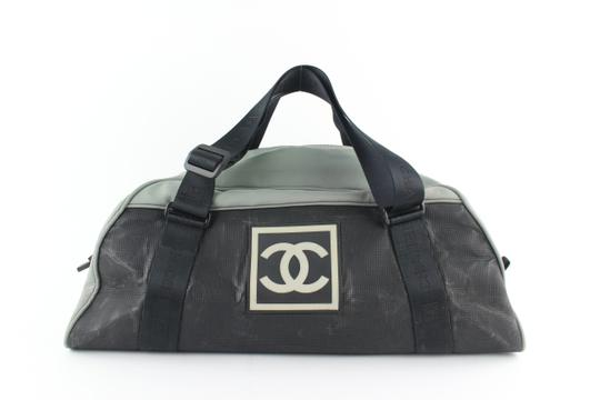 Preload https://img-static.tradesy.com/item/24546539/chanel-10cz1217-black-grey-nylon-rubber-weekendtravel-bag-0-0-540-540.jpg