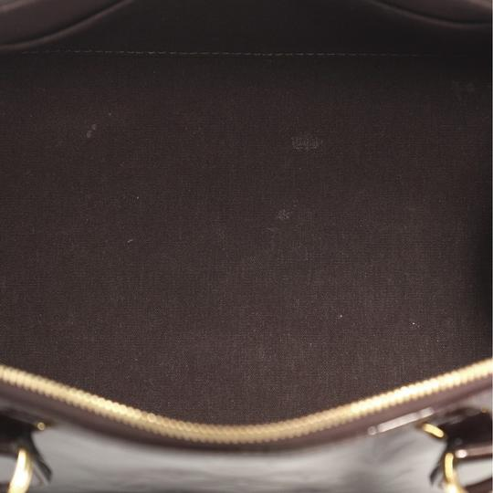 Louis Vuitton Handbag Leather Satchel in burgundy