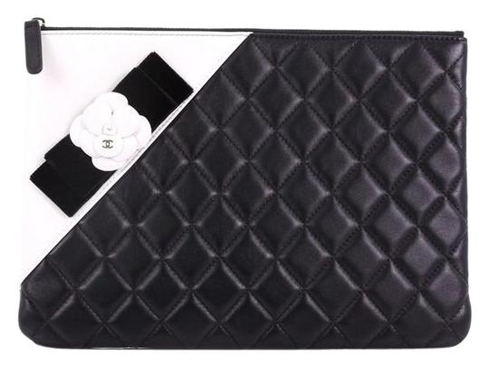 Preload https://img-static.tradesy.com/item/24546633/chanel-clutch-camellia-o-case-quilted-medium-black-lambskin-leather-clutch-0-1-540-540.jpg
