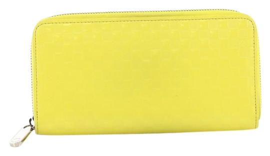 Preload https://img-static.tradesy.com/item/24546639/louis-vuitton-zippy-wallet-damier-facette-yellow-leather-wristlet-0-1-540-540.jpg