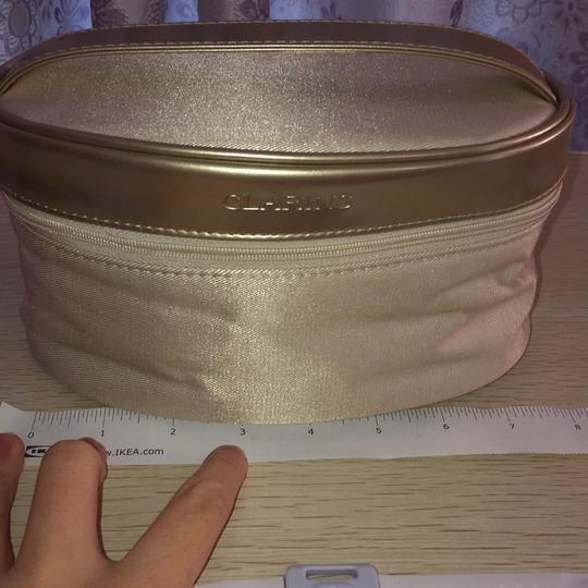 Clarins Clarins gold cosmetic bag Image 3